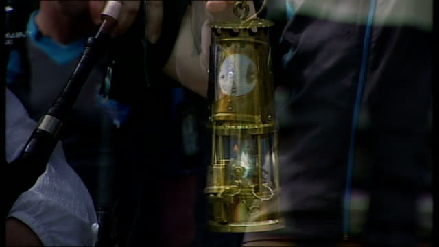 paralymic torch relay in scotland scotland ext paralympic torchbearers posing with lantern as woman plays bagpipes paralympic torchbearer carrying... - wheelchair basketball stock videos and b-roll footage