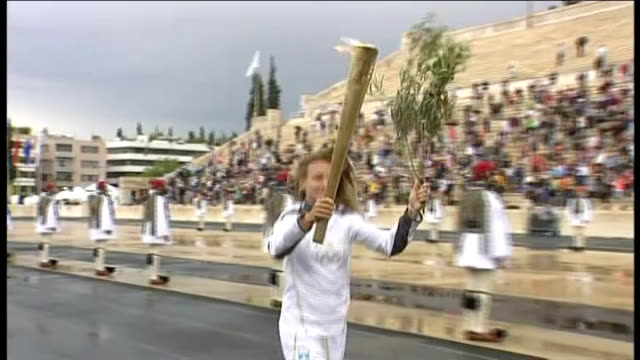 paralympic ambassador david beckham visits london school lib greece athens photography *** olympic torch being handed over to britain at ceremony and... - 式典点の映像素材/bロール