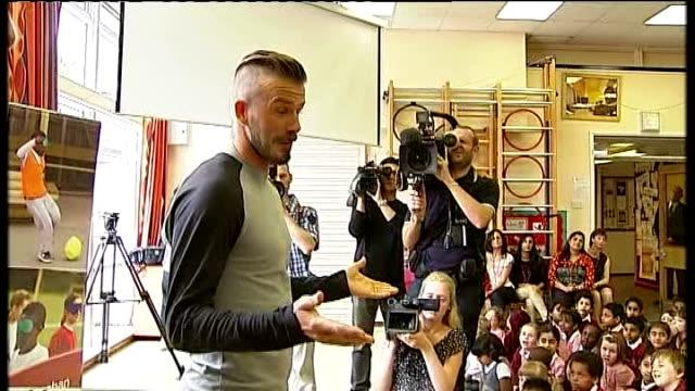 Paralympic ambassador David Beckham visits London school INT Beckham into school assembly to cheering SOT / Beckham answering children's questions...