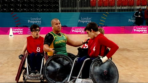 london 2012 paralympic games: wheelchair rugby test event; england: london: stratford: basketball arena: int **music heard sot** wheelchair rugby... - スポーツ ラグビー点の映像素材/bロール