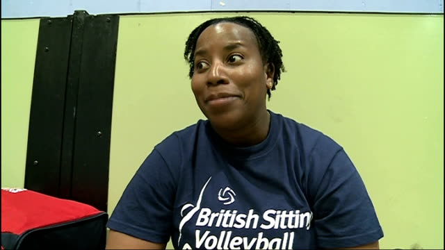 women's sitting volleyball team continue training Roehampton Sitting volleyball player throwing ball and chatting to teammates SOT Sitting volleyball...