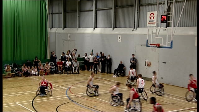 london 2012 paralympics legacy; buckinghamshire: stoke mandeville hospital: int disabled players taking part in wheelchair basketball competition on... - wheelchair basketball stock videos & royalty-free footage