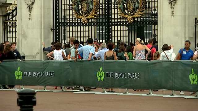 london 2012 two year anniversary games; gv buckingham palace and spectators behind barricade visitors looking through gates of palace ed warner... - barricade stock videos & royalty-free footage