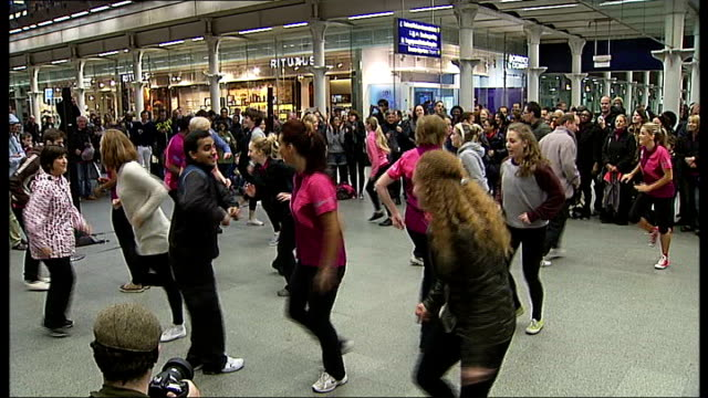 london 2012 volunteers flash mob england london st pancras int general views of flash mob dancers - flash mob stock videos and b-roll footage
