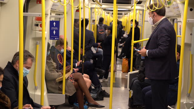 london 2021 commuters on tube train in masks - underground train stock videos & royalty-free footage