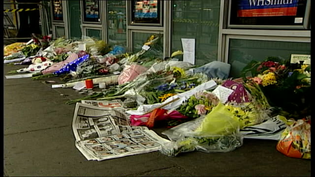 flowers at king's cross england london king's cross station ext flowers candles and message left outside station to remember victims of terrorist... - missing poster stock videos & royalty-free footage
