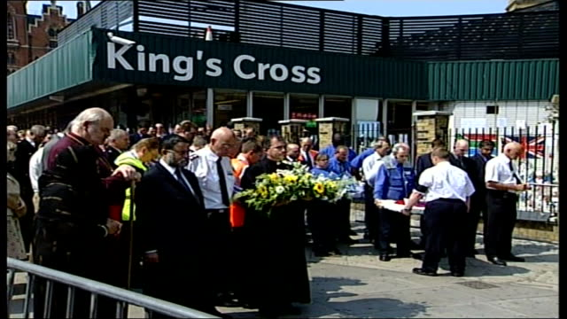 two minute silence at king's cross station england london king's cross group of people including muslim and christian religious leaders gathered to... - christianity stock videos & royalty-free footage
