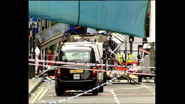 london 7th july 2005 attacks: bus bomb aftermath; england: london: tavistock square/woburn place: ext forensics investigators at scene / 'make... - bomb stock videos & royalty-free footage