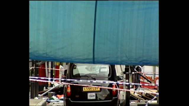 bus bomb aftermath england london tavistock square/woburn place ext screens covering up view of wreckage of london bus destroyed by bomb explosion as... - device screen stock videos & royalty-free footage