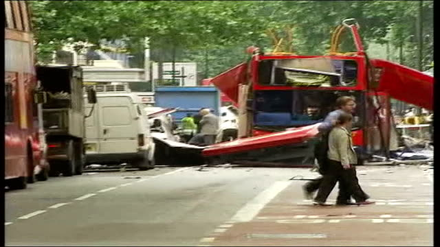 first anniversary file / tx england london ext wreckage of no30 bus in tavistock square following suicide bomb blast / fire engine along / medics... - trolley bus stock videos & royalty-free footage