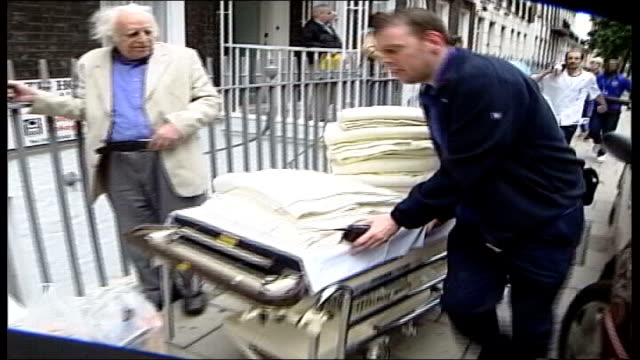 first anniversary fortunately there were lot of medical people in building / although this building is not equipped as hospitalwere ambulance crews... - trolley bus stock videos & royalty-free footage