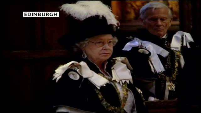 first anniversary scotland edinburgh st giles cathedral int queen elizabeth ii observing silence - order stock videos & royalty-free footage
