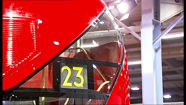 london acton int * * music overlay sot * * lifesize wooden model of newly designed routemaster bus close up of destination sign liverpool street... - mayor stock videos & royalty-free footage