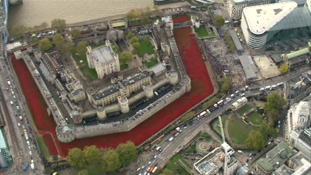 london aerials; england: london: ext **air views / aerials throughout** various aerials of tower of london with 'blood swept lands and seas of red'... - 堀点の映像素材/bロール