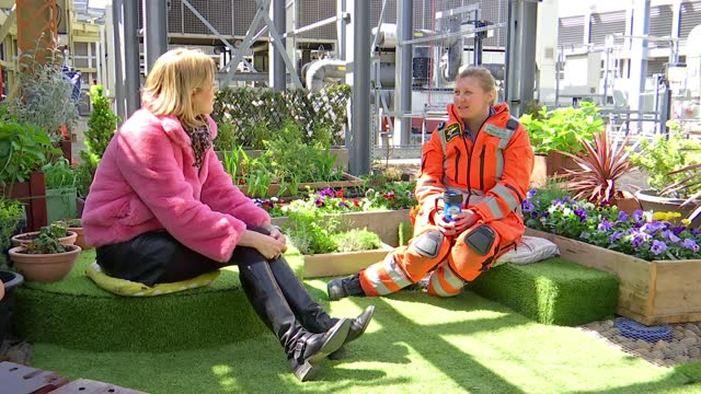 london air ambulance staff create relaxation space on hospital roof; london, uk; various shots of london skyline, various of london air ambulance on... - coworker stock videos & royalty-free footage