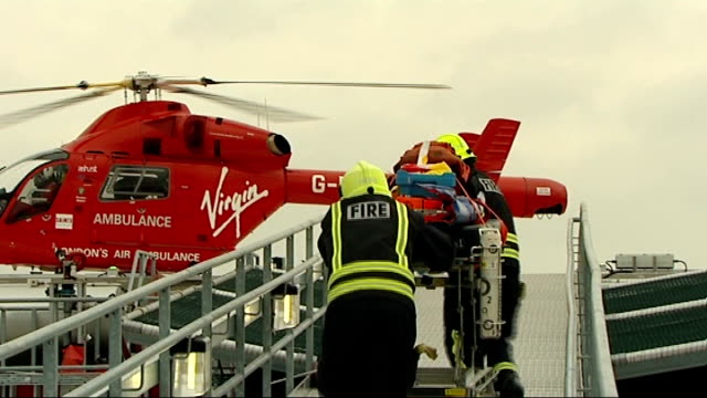london air ambulance to carry blood for emergencies england london royal london hospital ext london air ambulance touching down on helipad meera... - helipad stock videos & royalty-free footage