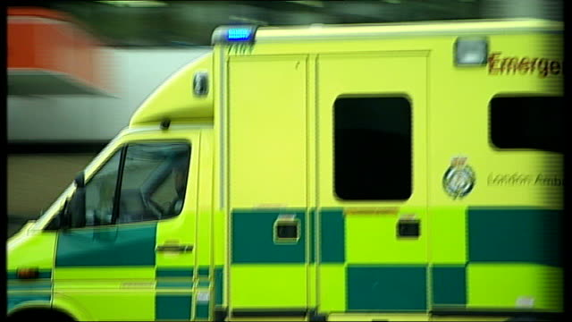 london ambulance service accused of sending out too many vehicles to same incident date unknown focus shot of ambulance along london ambulance lights... - kerb stock videos and b-roll footage