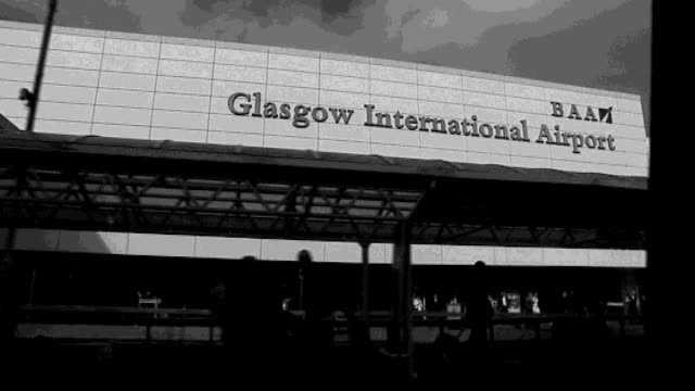 london and glasgow attempted bombings trial bilal abdulla evidence b/w slow motion tracking shot past glasgow airport building with sign - glasgow international airport stock videos & royalty-free footage