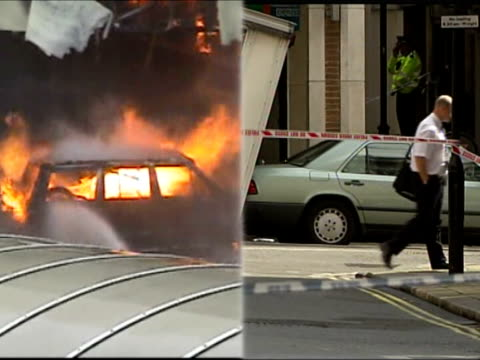 london and glasgow car bomb plots: arrests update; split screen burning jeep on fire outside glasgow airport / mercedes car being winched into van - the glasgow airport attack stock videos & royalty-free footage
