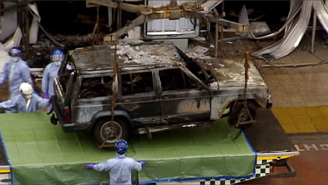 london and glasgow car bomb plots: the investigation; renfrewshire: glasgow airport: ext burned-out cherokee jeep winched from scene of attack - the glasgow airport attack stock videos & royalty-free footage