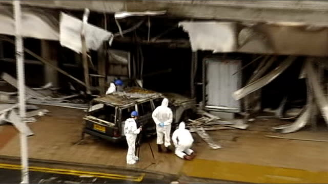 the investigation scotland renfrewshire glasgow airport ext forensic officers examining burnt out jeep at entrance to terminal building - glasgow international airport stock videos & royalty-free footage
