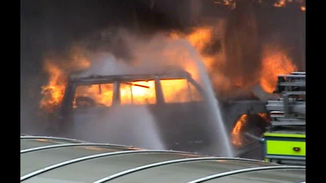 london and glasgow car bomb plots: the investigation; tx 1.7.2007 jeep on fire after attempted attack on airport - the glasgow airport attack stock videos & royalty-free footage