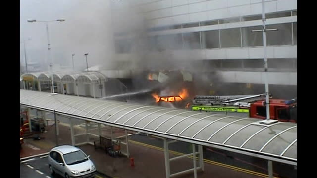 the investigation tx scotland renfrewshire glasgow airport strathclyde fire brigade fire engine and burning cherokee jeep outside air terminal - glasgow international airport stock videos & royalty-free footage