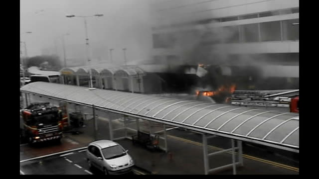 two nhs doctors accused tx scotland renfrewshire glasgow airport video footage of firefighters hosing water on burning car that crashed into the... - glasgow international airport stock videos & royalty-free footage