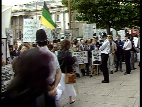 London AntiApartideid demo ENGLAND London South Africa Embassy MS Demo by AntiApartheid Movement outside S African Embassy holding placards watched...