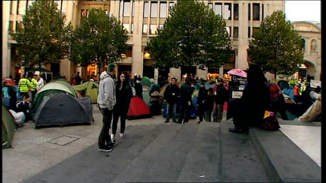 protesters outside st paul's cathedral england ext protesters and tents outside the west steps of st paul's cathedral in paternoster square / pigeons... - too small stock videos & royalty-free footage