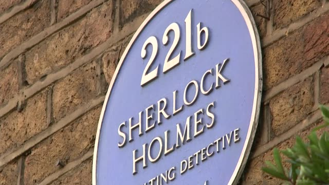 london anticorruption summit opens ext bus along outside house blurred shot of people along residential street close shot plaque '221b sherlock... - sherlock holmes stock videos & royalty-free footage
