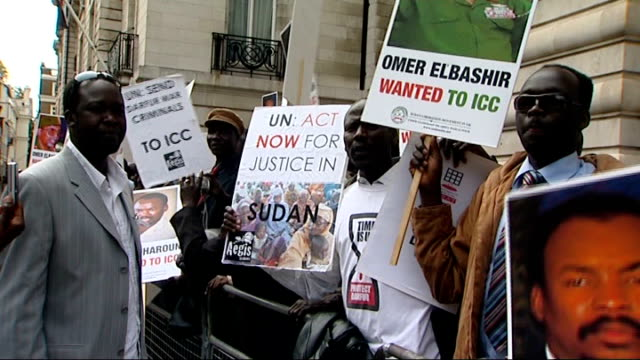 london antisudanese government protesters outside the sudanese embassy anwar barkar interview sot reporter to camera - genocide stock videos & royalty-free footage