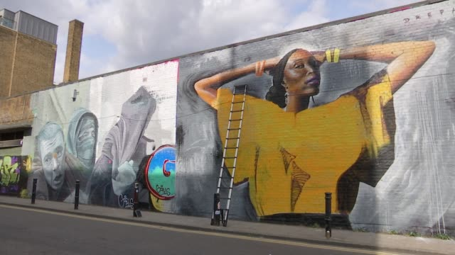 London artist Dreph creates large murals across city ENGLAND London Shoredithc EXT Shanley Blackman interview as looking at mural of herself SOT...