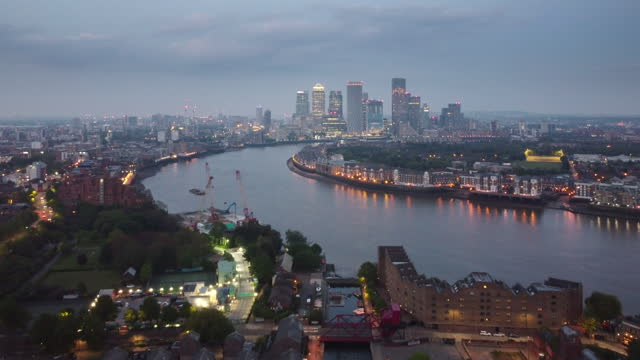 london at night from a high angle viewpoint overlooking the river thames looking east from shadwell basin. - london docklands stock videos & royalty-free footage