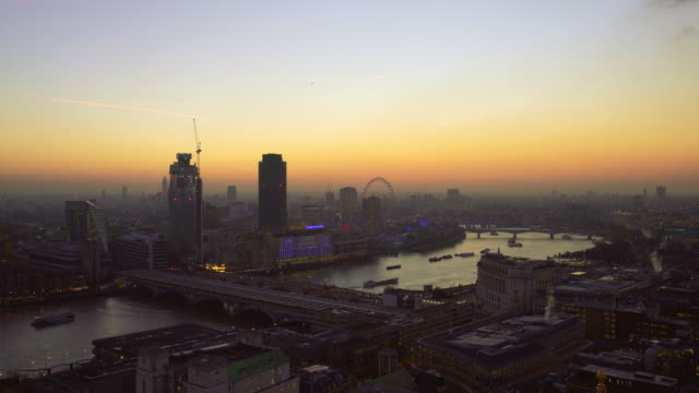 London at sunset with The Thames and The London Eye