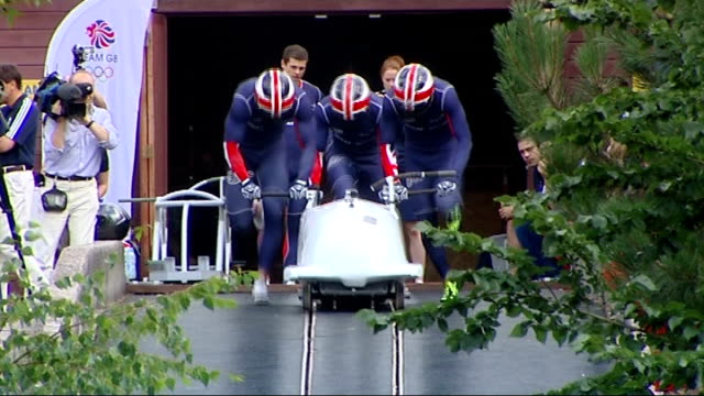 london athletes prepare for games r09081304 england somerset bath ext british men's bobsleigh team standing for team photograph various of gb men's... - bobsleighing stock videos & royalty-free footage