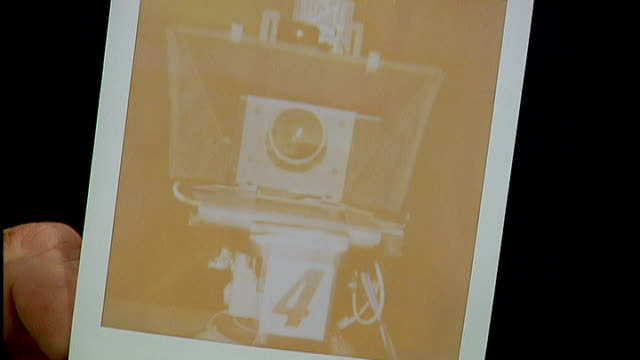 london atlas gallery int man taking picture with polaroid camera up shot of photograph developing polaroid cameras and photographs on display in... - polaroid video stock e b–roll
