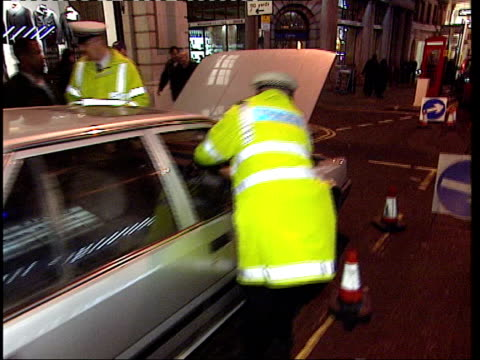 Attacks by unlicensed taxi drivers LIB Police officers checking unlicensed taxi cab TRACK