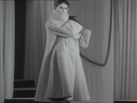 london autumn fashions; england: london: int long hostess coat and trousers ) michael ditto: ) otter-skin coat with striped collar: ) cd belt - coat... - striped stock videos & royalty-free footage