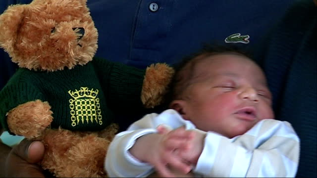 london baby contender for title of seven billionth human england london baby peter bashir yansaneh with house of commons teddy bear - house of commons stock videos and b-roll footage