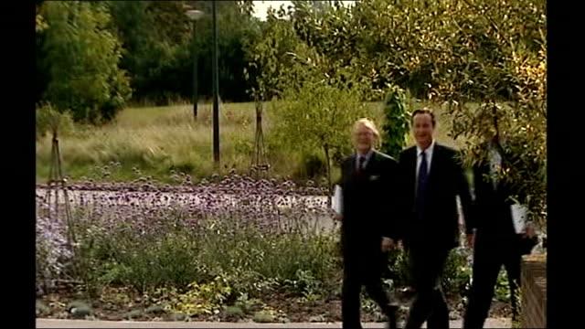 Barnes Wetland Centre EXT David Cameron MP walking with Zac Goldsmith and John Gummer MP