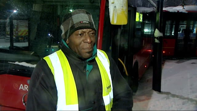 london bendy bus skids off road in thick snow general view of london transport worker speaking on mobile phone next lorry / person walking away thru... - 横滑り点の映像素材/bロール