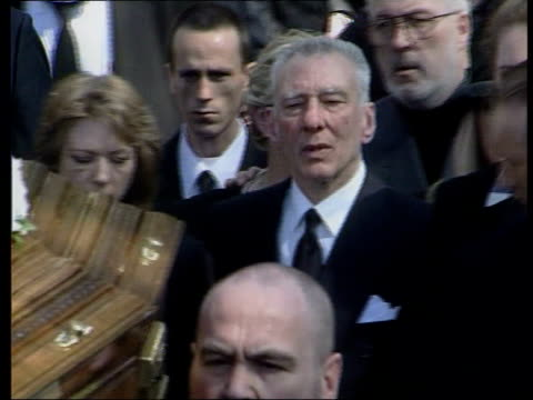 london bethnal green reggie kray along at funeral of his brother charlie kray reggie kray's hand handcuffed to prison officer kray along - bethnal green stock videos & royalty-free footage