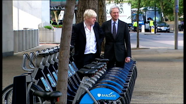 london bicycle hire scheme launched bike hire bicycles in docking station boris johnson and marcus agius photocall standing with hire bikes at... - bicycle parking station stock videos and b-roll footage