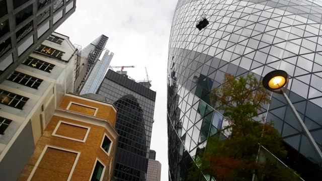 london bicycle ride around the gherkin skyscraper - low angle view stock videos & royalty-free footage