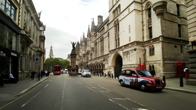 london bicycle ride in the strand at the royal courts of justice - royal courts of justice stock videos & royalty-free footage