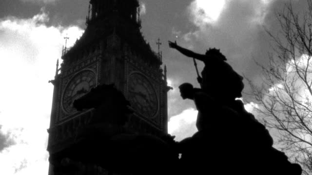 dx - london - big ben tower - clouds in sky - shooting up across silhouette boadicea monument - tower big ben in b.g. - b&w. (nit. neg) - 1936 stock videos & royalty-free footage