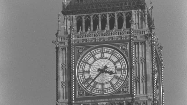 dx - london - big ben tower - c.u. the tower - the clock at 3:35 - b&w. (nit. neg) - clock tower stock videos & royalty-free footage