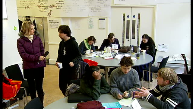 london bloomsbury university college london int hand written sign 'the war room' gv students working at laptop computers preparing for their next... - laptop bag stock videos and b-roll footage