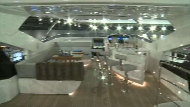 london excel centre int **music overlaid sot** high angle view of london boat show 2017 women attending show man drinking glass of champagne sign... - london boat show stock videos and b-roll footage